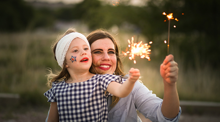 mother and child with a sparkler