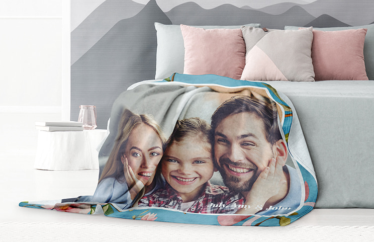 Custom fleece blanket of family on bed