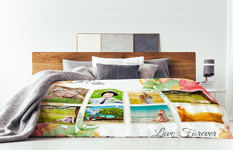 Plush throw blanket with custom design of couple photos on a sofa