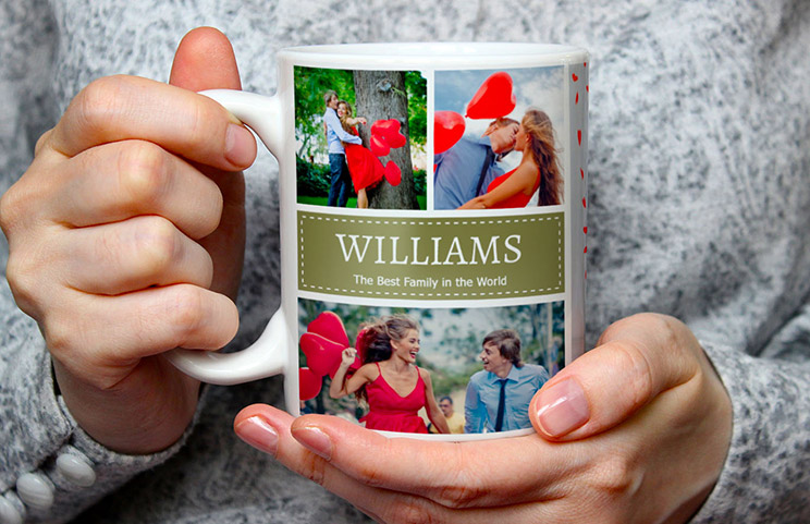 Close up of custom photo mug with a photo collage of family photos and text