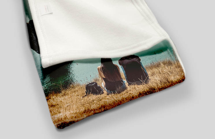 Child holding custom fleece blanket with pets