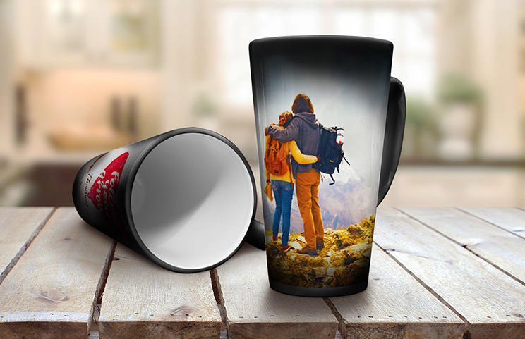 Two magic heat changing latte mugs with holiday photos and personalised text